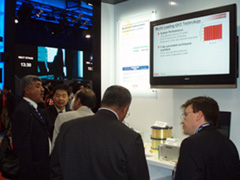 Toshiba displaying presentation at conference in Hong Kong
